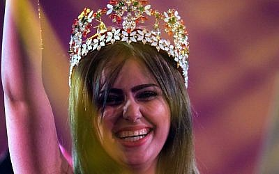 Iraqi Shaymaa Qasim, from the multi ethnic city of Kirkuk, waves after winning the Miss Iraq beauty contest on December 19, 2015 in the capital Baghdad. (Ahmad Al-Rubaye/AFP)