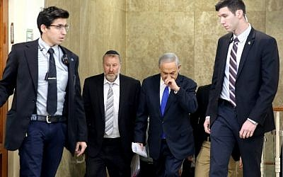 Israeli Prime Minister Benjamin Netanyahu, in second right, arrives with Cabinet Secretary Avichai Mandelblit, second left,  to the weekly cabinet meeting at his Jerusalem office on December 20, 2015. (AFP/POOL/GALI TIBBON)