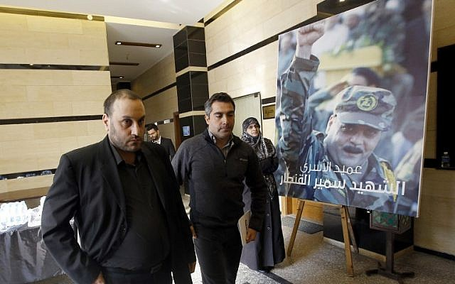 Bassam Kantar (left), brother of Samir Kantar (portrait-right) who was killed in a reported Israeli air raid in the Jaramana district on the outskirts of the Syrian capital Damascus, arrives to receive condolences in the southern suburb of the Lebanese capital Beirut on December 20, 2015. (ANWAR AMRO / AFP)