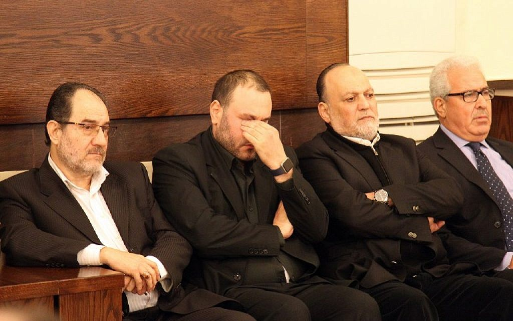 Bassam Kuntar (2nd left), brother of Samir Kuntar who was killed last night in a reported Israeli air-raid on his home in the Jaramana district on the outskirts of the Syrian capital Damascus, sits next to Hezbollah MP Ali Ammar (2nd right) as they receive condolences in the southern suburb of the Lebanese capital Beirut on December 20, 2015. (AFP PHOTO/ANWAR AMRO)