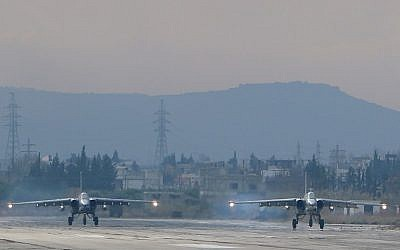 Two Russian Sukhoi Su-24 bombers at the Russian Hmeimim military base in Latakia province, in the northwest of Syria, December 16, 2015. (Photo by AFP Photo/Paul Gypteau)