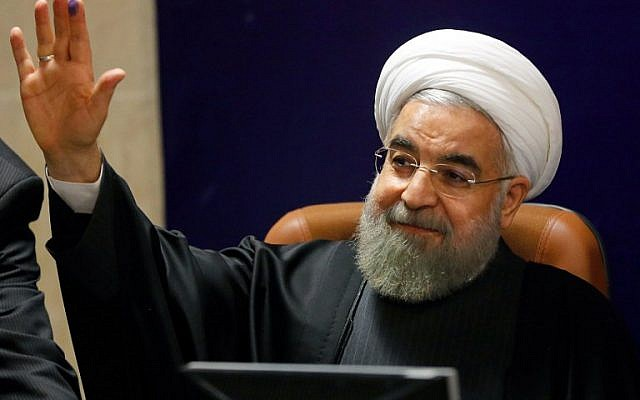 Iranian President Hassan Rouhani addresses a press conference at the interior ministry in Tehran, December 21, 2015. (AFP/Atta Kenare)