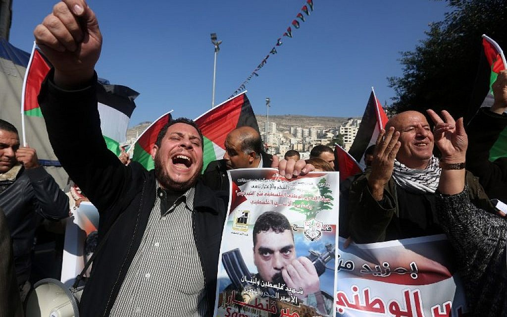 Illustrative: Palestinians chant slogans against Israel during a demonstration in support of late Lebanese terrorist Samir Kantar (portrait) in the West Bank city of Nablus on December 21, 2015. (AFP/JAAFAR ASHTIYEH)