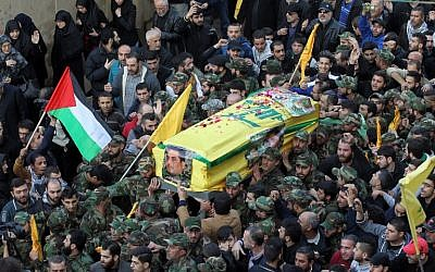 Members of Lebanon's Shiite militia Hezbollah carry the coffin of Samir Kuntar during his funeral outside Beirut on Monday, December 21, 2015 (AFP PHOTO/ANWAR AMRO)