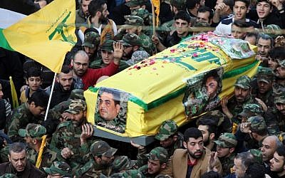 Members of Hezbollah carry the coffin of Lebanese terrorist Samir Kantar, who was killed in a suspected Israeli air raid on his home on the outskirts of Damascus, during his funeral procession in Beirut on December 21, 2015. (AFP PHOTO/ANWAR AMRO)