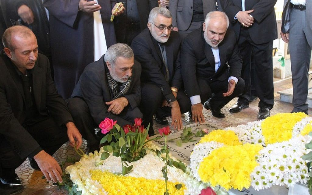 The Chairman of Foreign Policy and National Security Committee of Iran's parliament, Alaeddin Boroujerdi, 2nd right, and Hussain Shaikh Al-Islam, adviser to the head of the Iranian Shoura council, visits the grave of Samir Kuntar, a senior figure in terror group Hezbollah on December 27, 2015. (AFP/ANWAR AMRO)