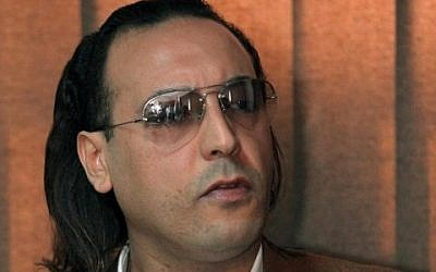 A file picture taken on March 1, 2010 shows Hannibal Gaddafi, a son of the late Libyan dictator Muammar Gaddafi, speaking to a jailed Swiss businessman during a meeting at Al-Jadaida prison on the outskirts of Tripoli. (AFP PHOTO / MAHMUD TURKIA)