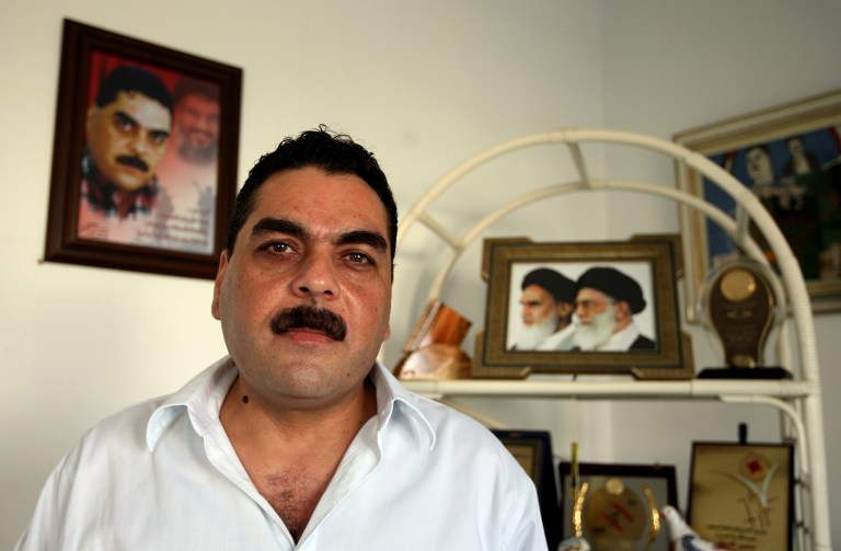 A file picture taken on October 22, 2008, shows Samir Kuntar posing for a picture during an interview on the outskirts of Beirut. In the background is a photograph of the Iranian supreme leader, Ayatollah Ali Khamenei (AFP PHOTO/JOSEPH BARRAK)