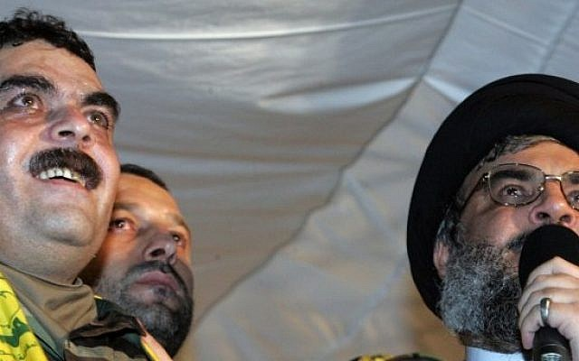 Lebanese Hezbollah chief Hassan Nasrallah, right,  speaking next to freed convicted terrorist Samir Kantar at a stadium in Beirut's southern suburbs, July 16, 2008. (AFP/MUSSA AL-HUSSEINI)