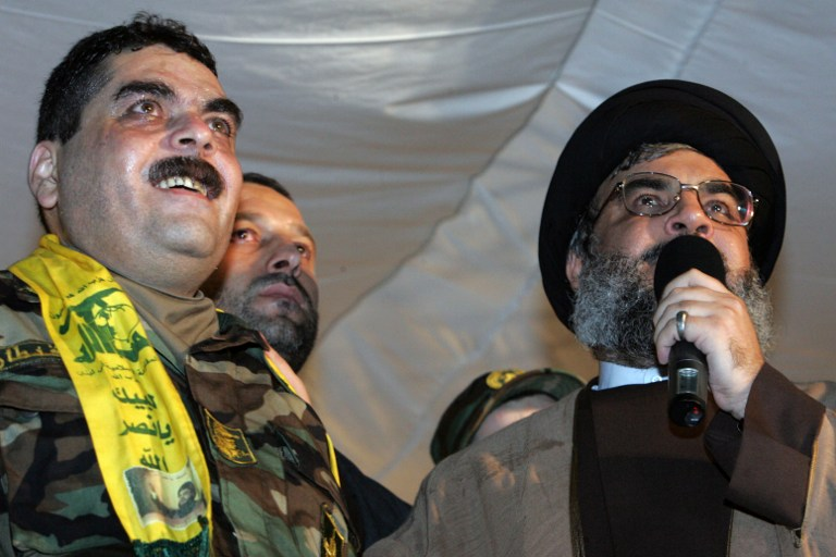 Lebanese Hezbollah chief Hassan Nasrallah (right) speaking next to freed Lebanese prisoner Samir Kuntar (left) at a stadium in Beirut, July 16, 2008. (AFP/Mussa al-Husseini, file)