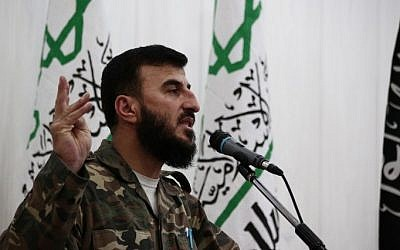 A file picture taken June 25, 2014 shows Zahran Allouch, the leader of Jaish al-Islam (Islam Army), speaking during a press conference in the rebel-held Eastern Ghouta region outside the capital Damascus. (Abd Doumany/AFP)