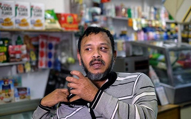 Muslim shopkeeper Sarkar Haque, who was beaten in an alleged hate crime, speaks during an interview at his shop in New York on December 7, 2015. AFP PHOTO/JEWEL SAMAD / AFP / JEWEL SAMAD)