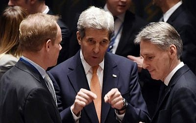 US Secretary of State John Kerry (C), British Foreign Secretary Philip Hammond (R) speak during a UN Security Council meeting on Syria at the United Nations, December 18, 2015. (Timothy A. Clary/AFP)