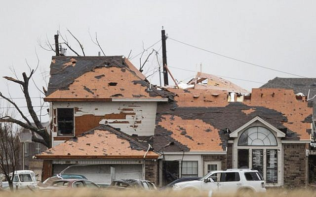 A house is damaged after a night tornado in Garland, Texas on December 27, 2015. (Photo by AFP Photo/Laura Buckman)