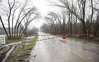 Barnes Bridge road is closed after a night tornado in Garland, Texas on December 27, 2015. (Photo by AFP Photo/Laura Buckman)