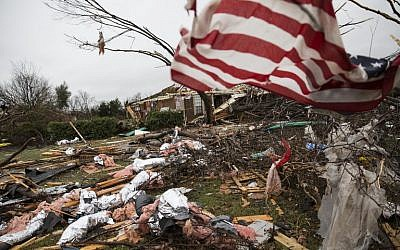 An American flag placed by first responders is seen December 27, 2015 in the aftermath of a tornado in Rowlett, Texas. (Photo by AFP Photo/Laura Buckman)