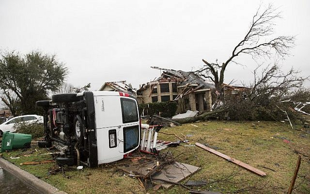 A heavily damaged area is seen December 27, 2015 in the aftermath of a tornado in Rowlett, Texas.  (Photo by AFP Photo/Laura Buckman)