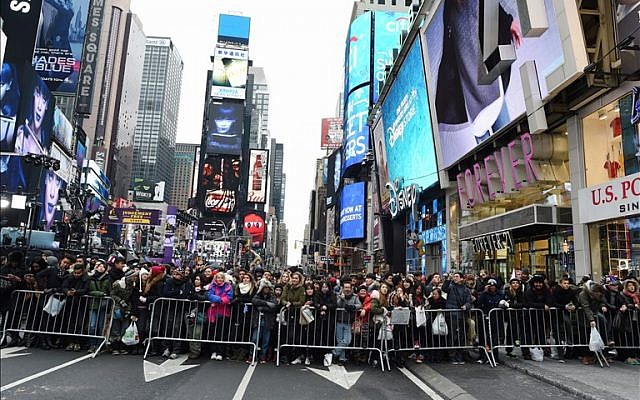 Revelers gather in Times Square waiting for the ball to drop on December 31, 2015 in New York.(AFP PHOTO/DON EMMERT)
