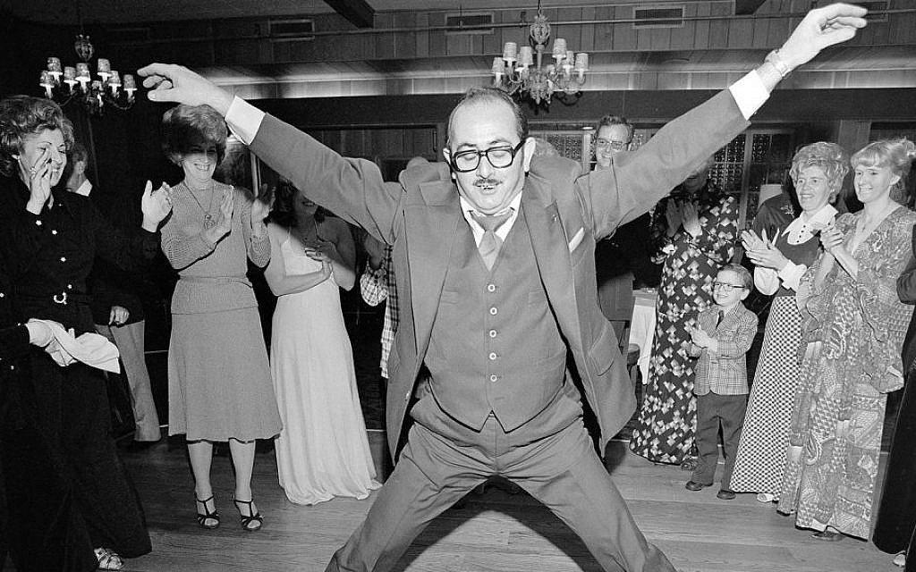Man in a 3 Piece Suit Dancing Within the Circle at a Wedding, Rockville Centre, NY, March 1976 (Detail) © Meryl Meisler Photography