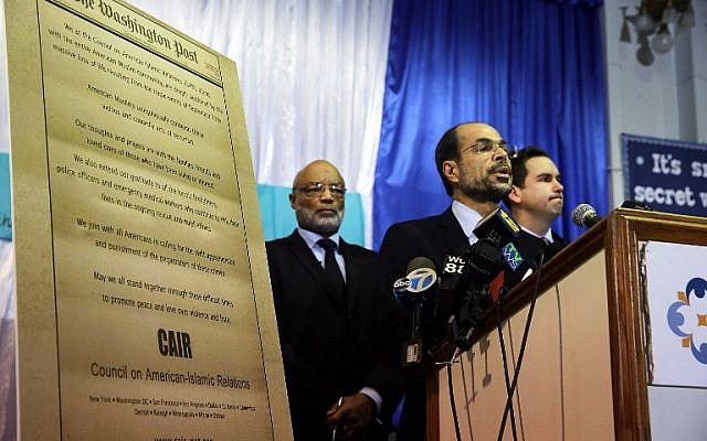 Nihad Awad, National Executive Director of the Council on American-Islamic Relations (CAIR) joins other community religious and political leaders at a news conference to address recent issues involving the New Jersey Muslim community on December 3, 2015 in Jersey City, New Jersey. Spencer Platt/Getty Images/AFP)