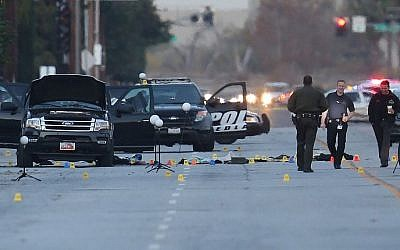 Law enforcement officials continue their investigation around the Ford SUV vehicle that was the scene where suspects of the shooting at the Inland Regional Center were killed, on December 4, 2015 in San Bernardino, California. (Joe Raedle/Getty Images/AFP)