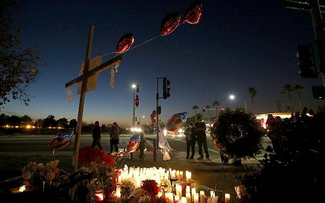 Mourners gather at a makeshift memorial near the Inland Regional Center on December 4, 2015 in San Bernardino, California, two days after a shooting attack by Syed Farook and his wife Tashfeen Malik killed 14 people at the Inland Regional Center. (Justin Sullivan/Getty Images/AFP)