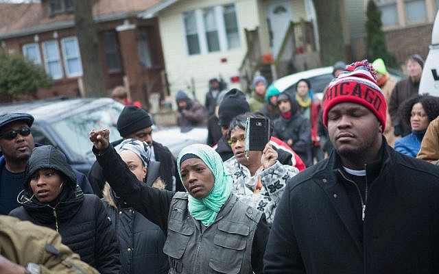 Family, friends and supporters gather outside the home of Bettie Jones and Quintonio LeGrier during a vigil on December 27, 2015 in Chicago, Illinois. (Scott Olson/Getty Images/AFP)