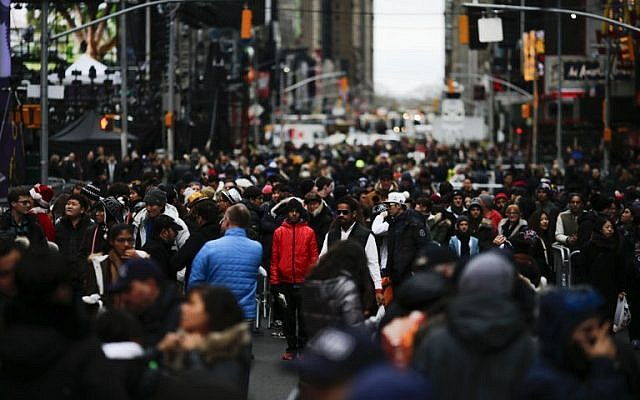 People gather for the New Year's Eve celebrations on December 31, 2015 in New York City. (Eduardo Munoz Alvarez/Getty Images/AFP)