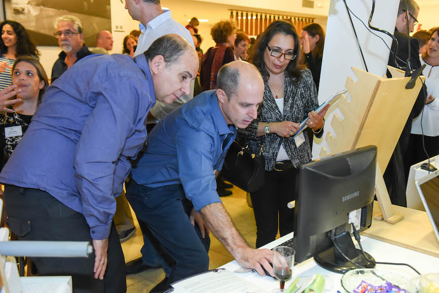 Visitors check out the technology at the A3I event, November 25 2015 (Courtesy)