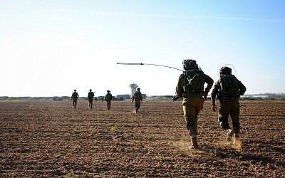 Illustrative photo of an IDF exercise near the Gaza Border on November 19, 2014. (Amit Shechter/IDF Spokesperson's Unit/Flickr)