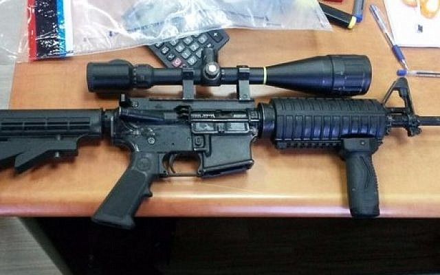 An M-16 with telescope sight sold to a police undercover agent who revealed a ring of criminals operating in the ultra-Orthodox Mea Shearim neighborhood of Jerusalem and in Ramat Beit Shemesh, an ultra-Orthodox offshoot of Beit Shemesh. (Israel Police)