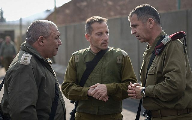 IDF Chief of Staff Gadi Eisenkot, left, speaks with Galil Division commander Amir Baram and head of the Northern Command Aviv Kochavi, during a visit to Israel's northern border on December 30, 2015. (IDF Spokesperson's Unit)