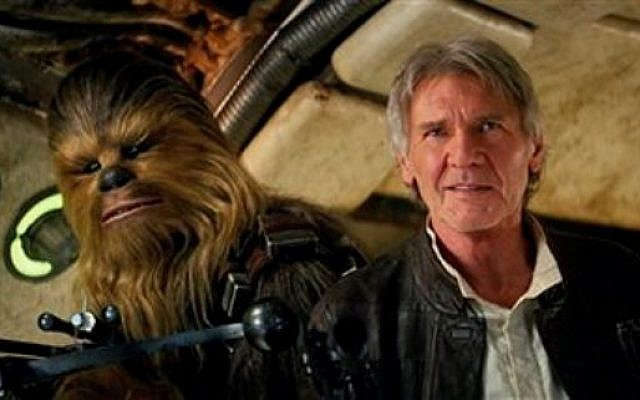 This photo provided by Lucasfilm shows Peter Mayhew as Chewbacca and Harrison Ford as Han Solo in 'Star Wars: The Force Awakens.' (Film Frame/Lucasfilm via AP)