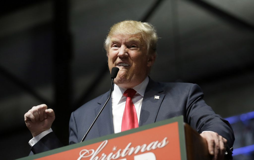 Republican presidential candidate, businessman Donald Trump, addresses supporters at a campaign rally, Monday, Dec. 21, 2015, in Grand Rapids, Mich. (AP Photo/Carlos Osorio)