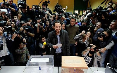 Pablo Iglesias, leader of the Podemos party, casts his vote in Spain's general elections in Madrid, Sunday, Dec. 20, 2015. (AP Photo/Emilio Morenatti)