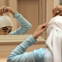 Illustrative photo of a Muslim woman adjusting her hijab. (AP/M. Spencer Green, File)