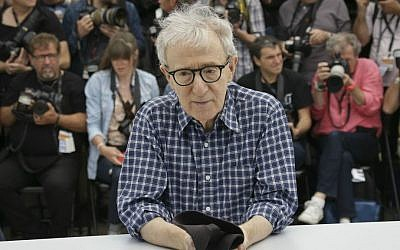 Director Woody Allen poses for photographers during a photo call for the film 'Irrational Man,' at the 68th Cannes International Film Festival in southern France, Friday, May 15, 2015. (Joel Ryan/Invision/AP)