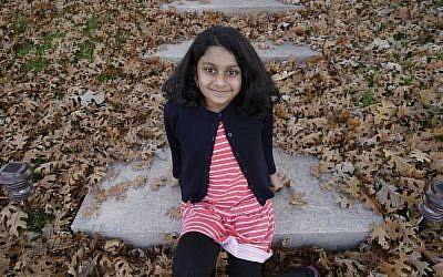 Noreen Shakil, 9, smiles for a photo on the steps outside her home in McKinney, Texas, on December 11, 2015. Donald Trump's remarks in the wake of the December 2 shooting attack in San Bernardino, California, have stoked fears in Muslim children across the US. (AP/LM Otero)