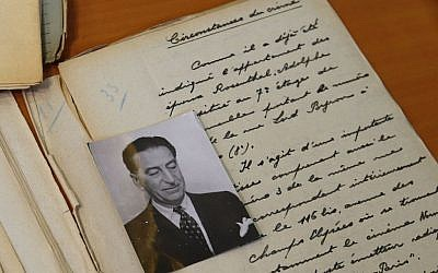 Files of the 1941 Rosenthal case are displayed by French historian Francois Le Goarant de Tromelin in the 'reading room' of the Paris Police Prefecture Archives department in Paris, France, Tuesday, Dec. 29, 2015. Adolphe Rosenthal, jeweller and diamond dealer born in Russia in 1877 and shot to death in Paris in September 1941 in unclear circumstances. (AP Photo/Francois Mori)