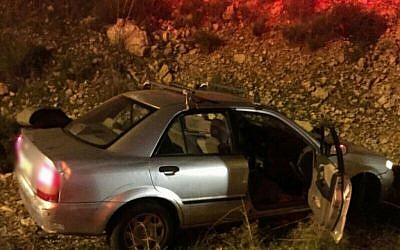 A crashed car on the side of the road after being shot at near the West Bank settlement of Avnei Hefetz on December 9, 2015. (Photo by Magen David Adom)