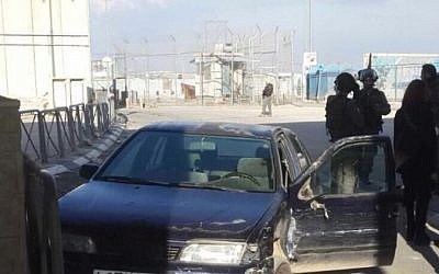 The scene after a Palestinian man attempted to ram his car into a group of police officers at the Qalandia checkpoint in the West Bank on December 18, 2015. (Israel Police)