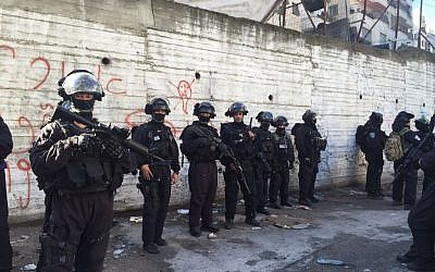 Israeli police at the scene of a home demolition in East Jerusalem's Shuafat refugee camp on Wednesday, December 2, 2015 (Israel Police)