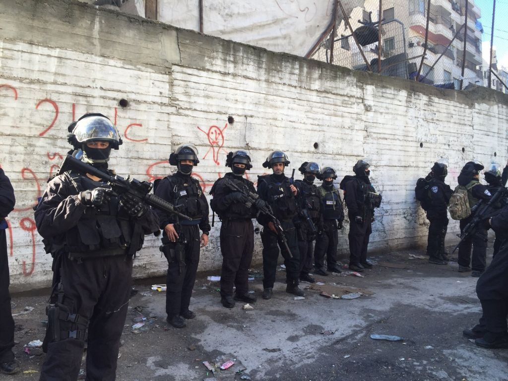 Israeli police at the scene of a home demolition in East Jerusalem's Shuafat refugee camp on Wednesday, December 2, 2015 (Israel Police)