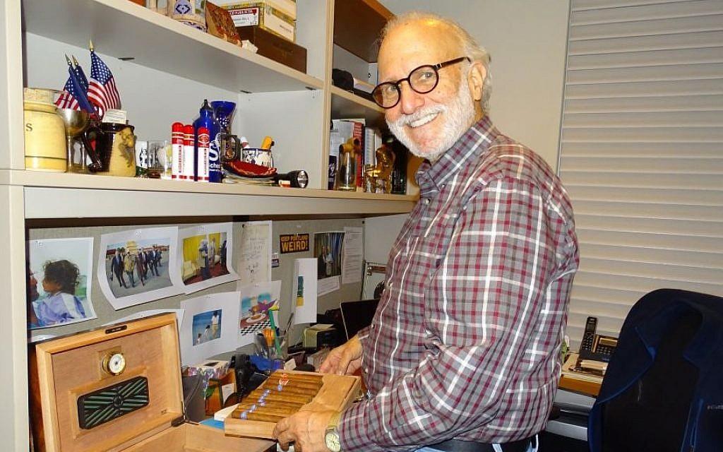 File: Alan Gross displaying his Cuban cigars at his apartment in Washington, DC, Dec. 23, 2015. (Suzanne Pollak/Washington Jewish Week)