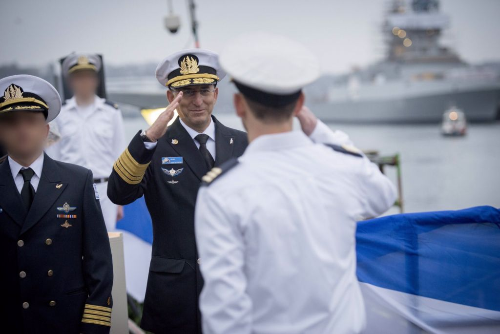 Israel Navy commander Ram Rothberg salutes the incoming crew of the INS Rahav, Israel's newest submarine, before it sets off from the German port of Kiel towards Haifa, where it is set to arrive next month, on December 17, 2015. (IDF Spokesperson's Unit)