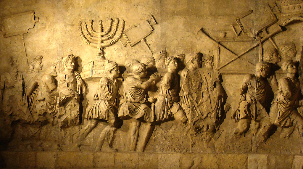 The Arch of Titus in Rome, depicting the triumphal parade of Roman soldiers leading away newly enslaved Jews after the sacking of Jerusalem in 70 CE (CC via Wikipedia)