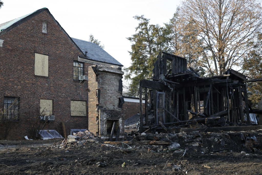 The remains of a construction site destroyed by arson is seen in the Forest Hills section of Queens in New York, Monday, Dec. 7, 2015 (AP Photo/Seth Wenig)
