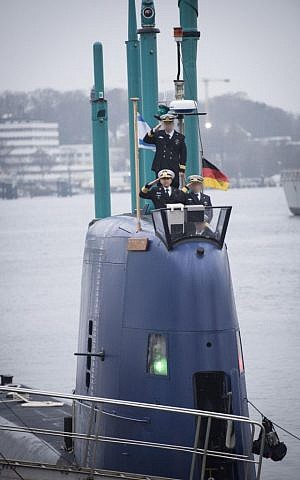Israel Navy commander Ram Rothberg salutes as the INS Rahav, Israel's newest submarine, sets off from the German port of Kiel towards Haifa, where it is set to arrive next month, on December 17, 2015. (IDF Spokesperson's Unit)