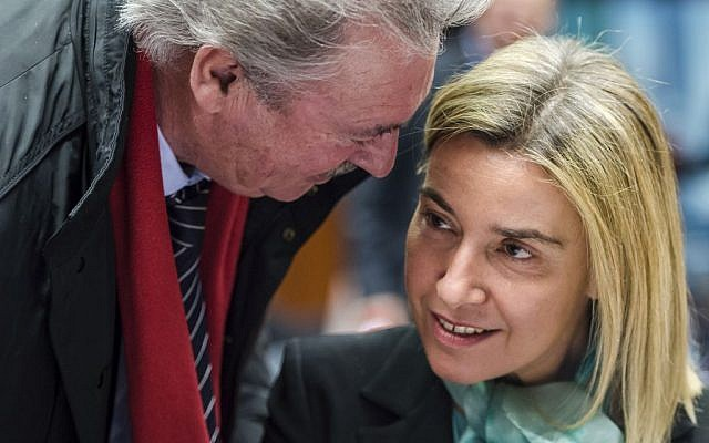 Luxembourg's Foreign Minister Jean Asselborn (left), talks with EU Foreign Policy Chief Federica Mogherini during an EU meeting of foreign ministers at the EU Council in Brussels, Belgium, December 14, 2015. (AP/Geert Vanden Wijngaert)