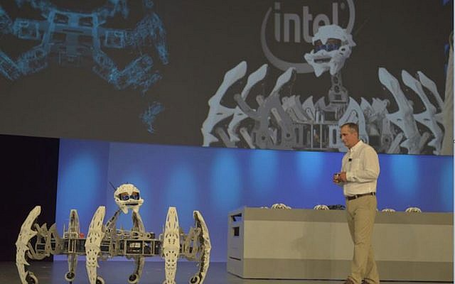 Intel CEO Brian Krzanich controlling a hoard of spider bots with a wave of his hand, via Intel RealSense at the Intel Developer Forum, August 18, 2015 (Intel)
